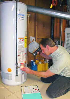 Centennial plumbing contractor repairs a water heater